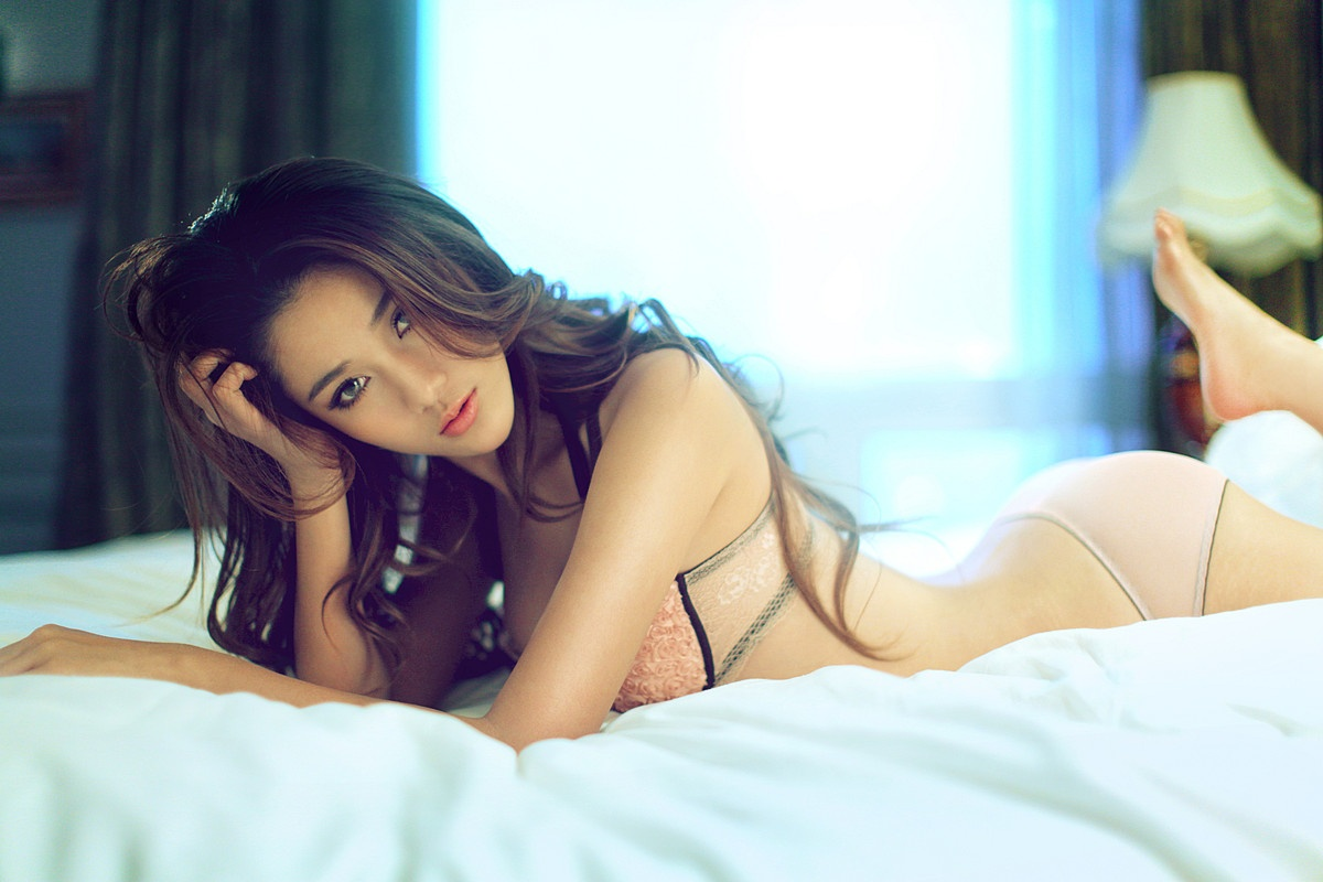 cool girl laying bed in lingerie